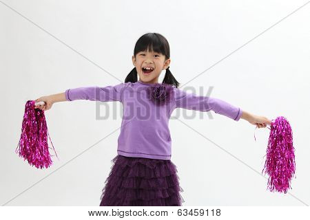 Happy chinese girl holding pom pom
