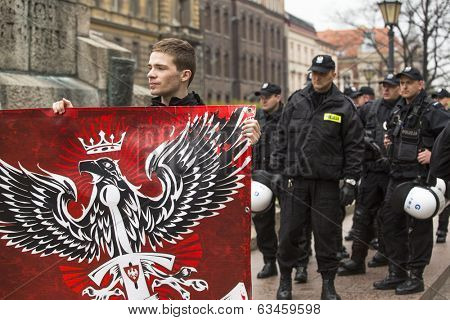 KRAKOW, POLAND - APR 13, 2014: Unidentified participants IV Procession Katyn in memory of all murdered in Apr 1940, more than 21,000 Polish prisoners from NKVD camps and prisons at behest of I. Stalin.