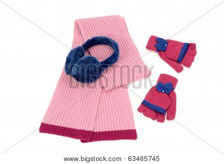 Pink wool scarf, a pair of gloves and earmuffs nicely arranged.