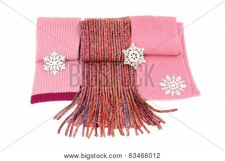 Three cute pink winter scarves with snowflakes.
