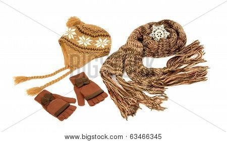 Brown wool scarf, a pair of mittens and a hat nicely arranged.