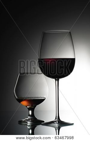 Two glasses of alcohol drinks, wine and cognac