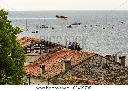 Rovinj, Croatia - April 13 2014 Spectators On Roof At Red Bull Air Race Event