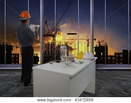 Male Engineer Checking Work Flow In Building Construction Site Against Beautiful Dusky Sky Use For C