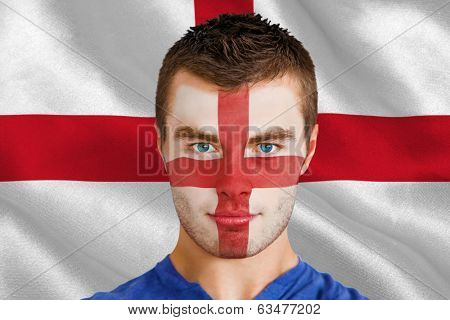 Composite image of serious young england fan with facepaint against digitally generated english national flag