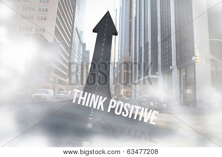 The word think positive against road turning into arrow