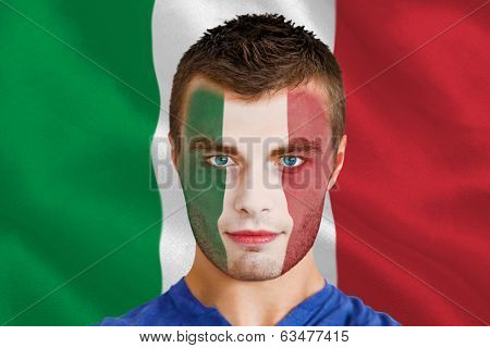 Composite image of serious young italy fan with facepaint against digitally generated italian national flag