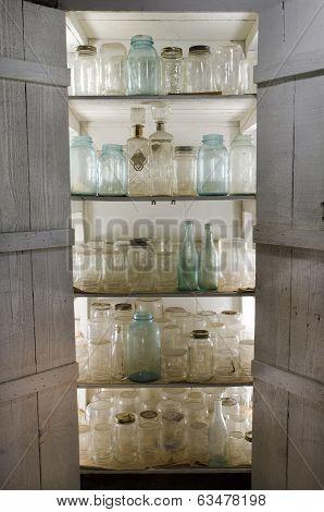 Shelves of Old Canning Jars