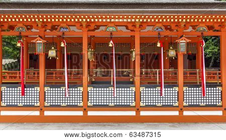 Traditional Shinto Architecture And Stone Lanterns At Fushimi Inari Shrine In Kyoto