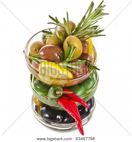 Border stack of olives dish with vegetables, herbs, spices isolated on a white background