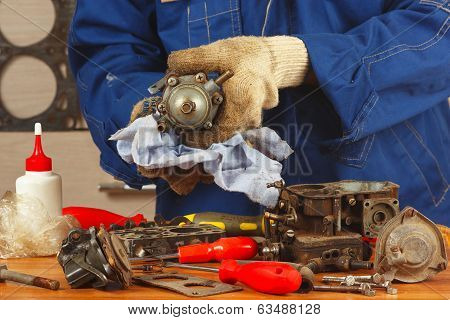 Master repairing old car engine fuel pump