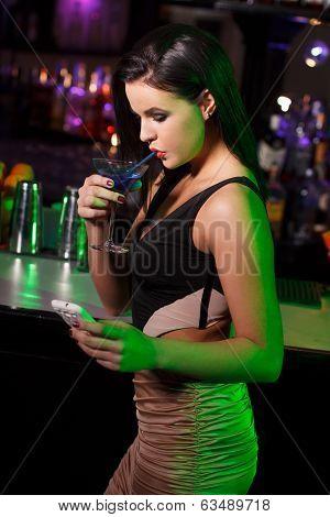 Woman Drink Blue Vodka In Bar