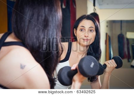 Nice Woman Working Out With Dumbbells
