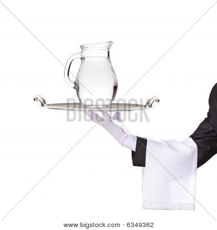 Waiter Holding A Silver Tray With A Pitcher