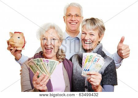 Happy senior people with Euro and dollar bills and piggy bank holding thumbs up