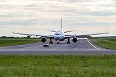 stock photo of car carrier  - Aircraft taxiing for follow me car at the airport - JPG