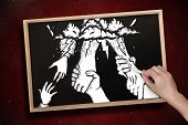 Composite image of hand drawing helping hands with chalk on chalkboard with wooden frame