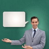 Young businessman presenting something against speech bubble