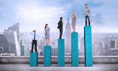 Composite image of business people standing on bar chart depicting growth