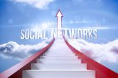 The word social networks against red steps arrow pointing up against sky