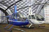 MOSCOW, RUSSIA - DEC 21, 2013: New small helicopters in hangar of Heliport Moscow - unique project t