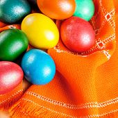 colorful easter eggs on the orange napkin