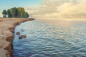 Tranquil Danube river shore at sunrise