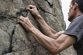 foto of italian alps  - hands of man climbing on rock, italian Alps