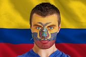 Composite image of serious young ecuador fan with facepaint against digitally generated ecuador nati