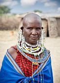 TANZANIA, AFRICA-FEBRUARY 9, 2014: Masai woman with traditional ornaments, review of daily life of l