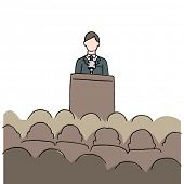 An image of a man making a public speech.