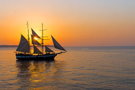 picture of sloop  - A romantic sunset with a sailing ship seen at the greek islands - JPG