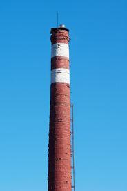foto of lightning-rod  - High old brick chimney with lightning rod - JPG