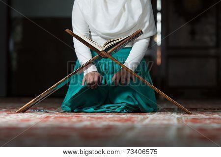 Close Up Muslim Woman Is Reading The Koran