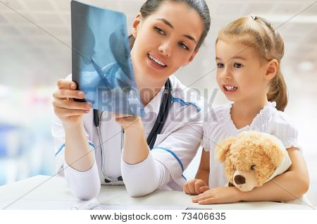 doctor examining a child in a hospital