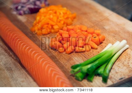 Fresh Salmon With Chopped Vegetables On A Board