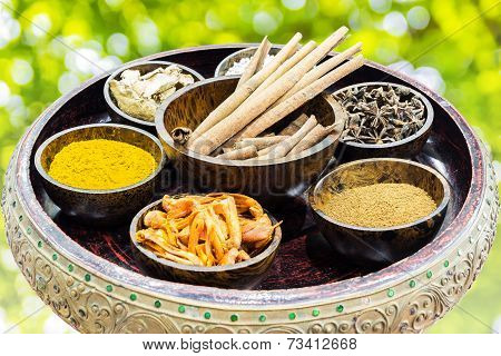 Spices And Herbs In Wooden Bowl