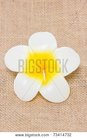 Plumeria Flower Candles Isolated On Sackcloth.