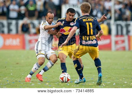CARSON, CA - SEPT 28:  Landon Donovan and Tim Cahill in action during the Los Angeles Galaxy MLS game against the New York Red Bulls on Sept 28th, 2014 at the StubHub Center.