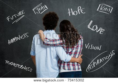 Young Couple With Arm Around Each Other Hope For a Better Future Over Gray Background