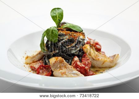 Black Spaghetti with Sea Bass and Batarga (dried, salted, pressed red roe) and Dried Cherry Tomato. Served with Fresh Corn Salad Leaves