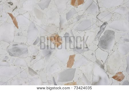Macro shot of cracked terrazzo floor