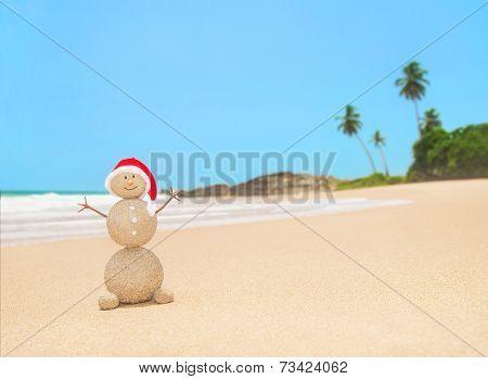 Christmas Sandy Snowman In Santa Hat At Palm Ocean Beach