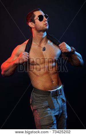 Muscular man in sunglasses