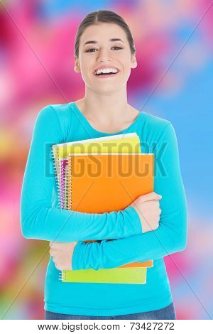 Beautiful young woman student with workbook.