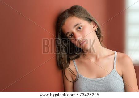 Beautiful hispanic teenage girl with a serious expression
