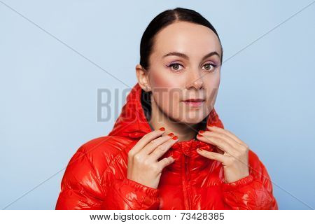 Face portrait of a woman in an autumn jacket