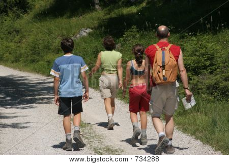 Family walking mountain path