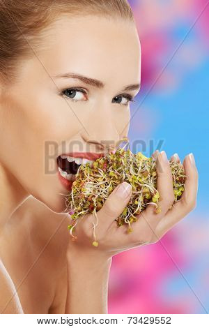Beautiful caucasian topless woman with fresh green cress