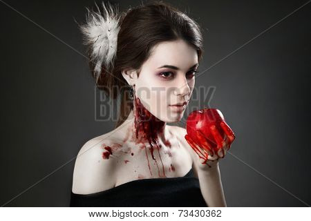 Portrait of a female vampire over black background
